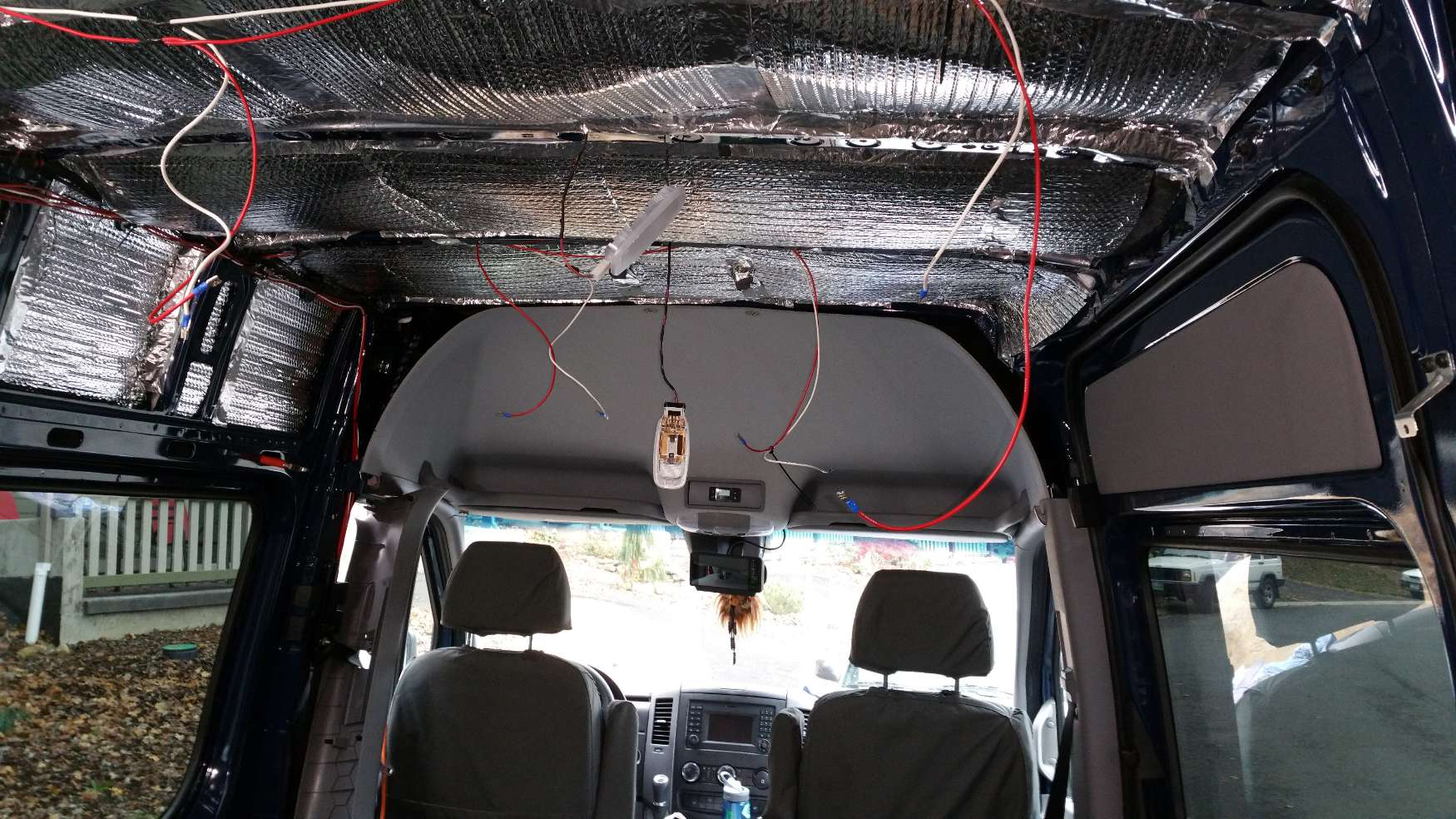 converting a sprinter van to a camper installing the electricalwires, wires everywhere